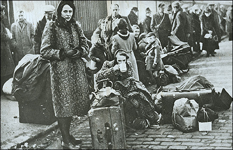 Evacuees queuing at Whitecrook Street