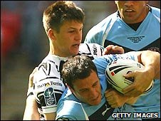 Hull winger Tom Briscoe tackles Lee Gilmour during the 2008 Challenge Cup final