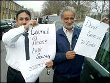 Taxis drivers hold up protest signs