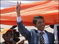 Andry Rajoelina flashes the V sign during a rally in Antananarivo, 14 March