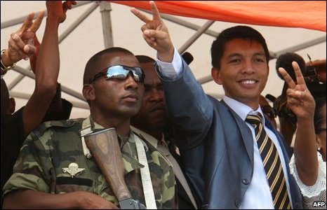 Madagascar's opposition leader Andry Rajoelina, right, addresses a rally in Antananarivo, Madagascar, 14 March 2009