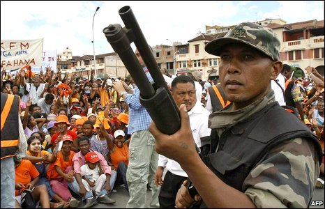 A soldier and crowds at an address by opposition leader Andry Rajoelina in Antananarivo, Madagascar, 14 March 2009