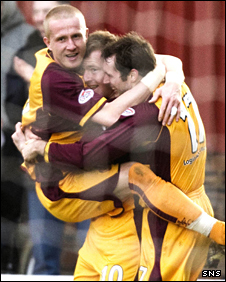 David Clarkson is congratulated after heading the winner for Motherwell