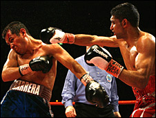 Amir Khan (right)