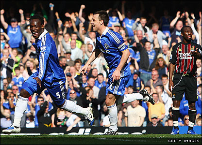 Michael Essien celebrates the opening goal