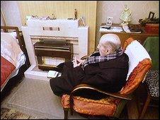 Pensioner in living room
