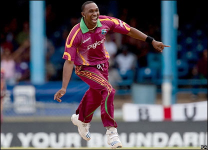 Dwayne Bravo celebrates the wicket of Steve Davies