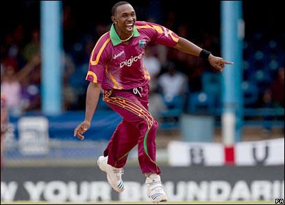 Dwayne Bravo celebrates the wicket of Steve Davies
