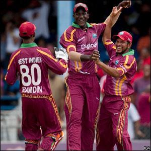 Denesh Ramdin, Darren Sammy and Ramnaresh Sarwan celebrate after Gareth Batty is run out