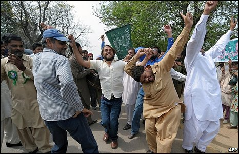 Opposition supporters dancing in the street in Islamabad, Pakistan