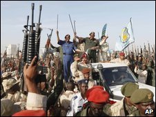 President Bashir on top of a vehicle gestures to army soldiers during a military rally in Khartoum 16 March