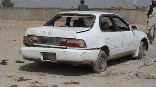 Car damaged by the explosion in Lashkar Gar