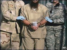 A shackled detainee at Guantanamo Bay. File photo (6 December 2006)