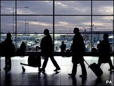 Air travellers at Luton Airport in silhouette