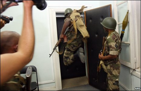 Madagascan soldiers loyal to opposition leader Andry Rajoelina attempt to break down an office door during a take-over of the offices of President Marc Ravalomanana in Antananarivo on March 16, 2009