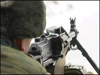 Russian soldier firing machine gun