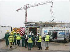 The collapsed crane and an ambulance attending to the casualties