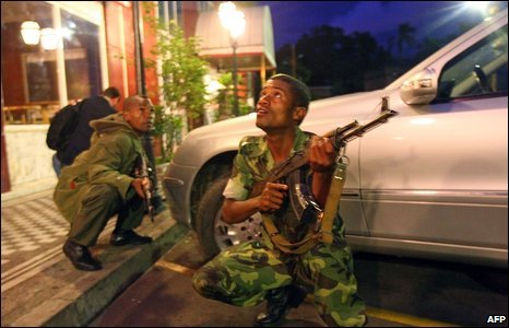 Madagascan soldiers loyal to opposition leader Andry Rajoelina take position during the take-over of the office of President Marc Ravalomanana in Antananarivo on March 16, 2009.