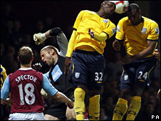 West Ham keeper Robert Green (second left) goes down after a challenge