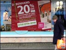 Man walking past Debenhams store