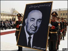 Afghan army officers carry a portrait of former president Mohammad Daud Khan during his funeral in Kabul on March 17, 2009