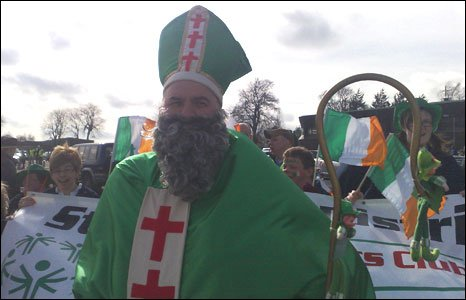 St Patrick leads the St Patrick Day's parade in Strabane