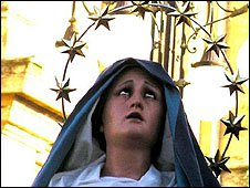 A statue of the Virgin Mary, with a circle of stars forming a halo around her head