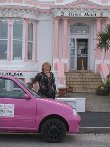 Ann Blanchard and her pink car