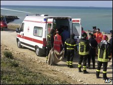 Paramedics treat a German tourist (not seen) mauled by dogs near Ragusa, Sicily, on 17 March