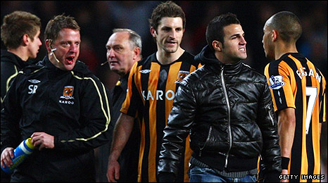 Fabregas (second from right) and Horton (third from the left) experience different emotions on the pitch after the match