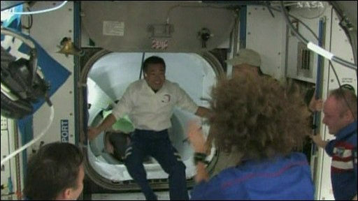 Crew from Nasa's Discovery shuttle are welcomed to the International Space Station