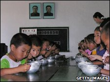 Kids eating at orphanage, Taedong Country, N Korea, WFP handout 2005