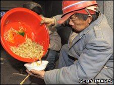 Worker has lunch, Liaoning Province, China, March 2009