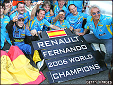 Fernando Alonso (left) and Renault boss Flavio Briatore (right) celebrate taking the titles in 2006