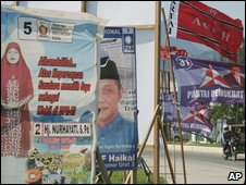 Posters and flags of election candidates in Aceh.