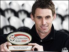 Andy Dorman shows off his award