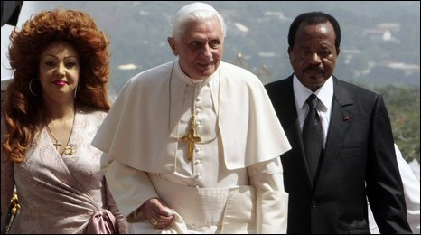 President Paul Biya (right) and his wife Chantal accompany the Pope into the Unity Presidential Palace