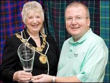 Provost Ruth Leslie Melville and David Valentine, the council's head of economic development with the golf trophy
