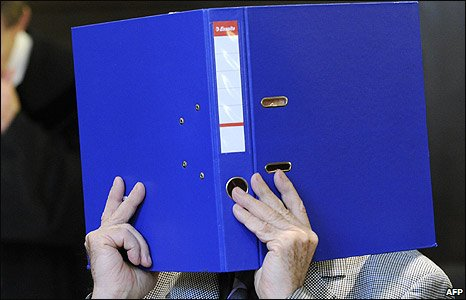 Josef Fritzl hides his face behind a blue folder in court before his trial in St Poelten, Austria (17 March 2009)
