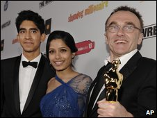 Slumdog Millionaire stars Dev Patel and Freida Pinto with director Danny Boyle celebrating Oscar wins in February