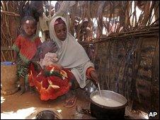 A family cooks rice in arid Shibir-Fatuma, Kenya, last month