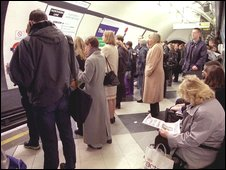 Passengers waiting on Tube platform