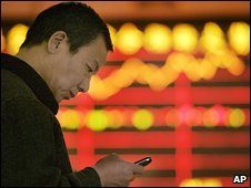 A Chinese man checks his mobile phone
