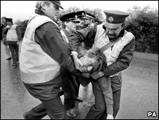 An injured picket is carried by ambulance men during the Battle of Orgreave