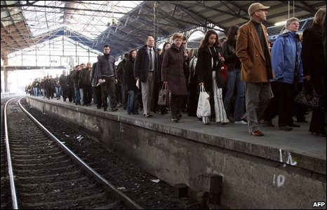 People walk on the platform at the Gare Saint-Lazare train station
