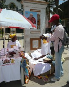 Popesellers: a stall in downtown Luanda with pope merchandise