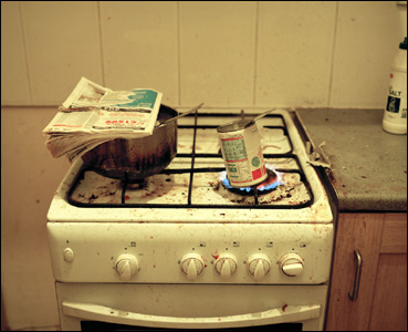 Food heating in tin on dirty stove