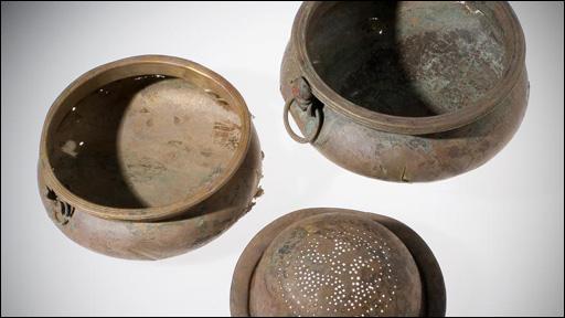 Bronze bowls and bronze wine strainer declared treasure trove