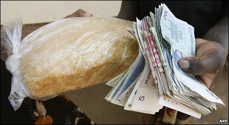 Man holding a loaf of bread (File photo)