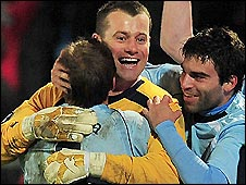 Man City keeper Shay Given is congratulated by team-mates after his heroics in the penalty shoot-out win over Aalborg